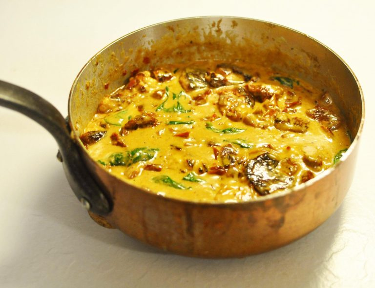 Creamy halloumi stew with sun-dried tomatoes and spinach